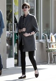 Anne Hathaway went for a retro look while out in California. The star paired a boxy wool coat with skinny pants and flats to complete her look.
