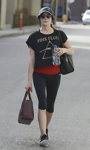 Ashley Greene paired her rock band crop top over a workout top for a sport but edgy look.