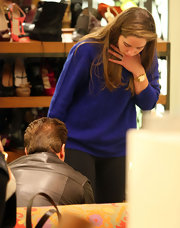Christina Schwarzenegger went shopping at Barney's in a royal blue cable knit sweater.