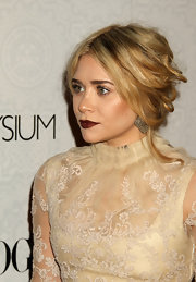 Ashley looked like a vintage doll in a full-length lace ensemble, burgundy lipstick and a messy, center-parted updo.