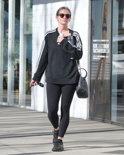 Ashlee Simpson teamed a black Adidas sweatshirt with matching leggings for her workout look.
