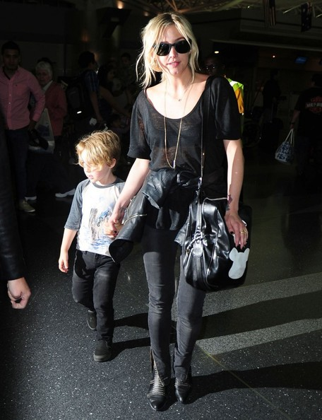 Ashlee Simpson in a stylish black tee.