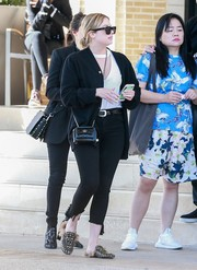 Ashley Benson teamed a black Comme des Garcons cardigan with capri jeans for a day of shopping.