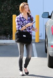 Ashley was spotted in LA toting a black crochet satchel.