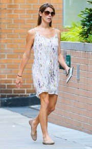 Ashley Green took a walk in New York City wearing an airy watercolor-print shift dress by Helena Quinn.