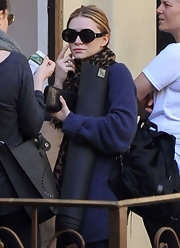 Ashley Olsen loves her oversize frames. Here the mogul dons round framed sunglasses.