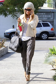 Ashley Tisdale brought daytime sparkle into her look with a pair of pewter sequined harem pants.
