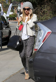 Ashley Tisdale gave her eclectic street wear a luxe touch with a classic black quilted leather tote.