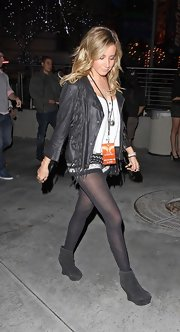 Ashley Tisdale embraced a boho rocker style in a fringed leather jacket and barely there shorts.