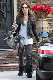 Ashley Tisdale grabbed coffee carrying her Gucci Crest Boule Fabric Tote. A playful raccoon tail dangles from the purse.