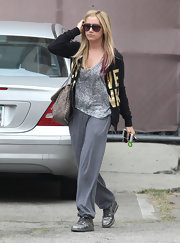 Ashley Tisdale topped off her casual look with metallic kicks.