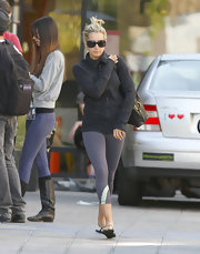 A low-key Ashley Tisdale headed to lunch in a plain black track jacket and tight gray workout pants.