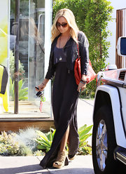 Ashley Tisdale topped off her look with cutout platform booties.