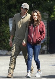 Mila Kunis stayed comfy in a maroon hoodie and skinny jeans while out and about.