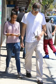 A pair of gray sneakers from Native Shoes finished off Mila Kunis' attire.