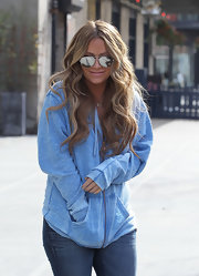 Aubrey O'Day styled her long tresses in subtle curls while leaving her New York Hotel.