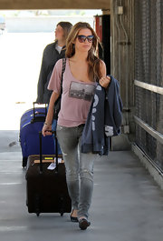 Audrina rocks every satrs essential accessory when at the airport, a huge pair of sunglasses.