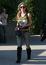 Audrina never leaves home without her chain strap chanel purse, it virtually goes with everything she owns.