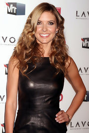 Audrina Patridge stepped out for the OK magazine party with tousled curls teased at the ends.