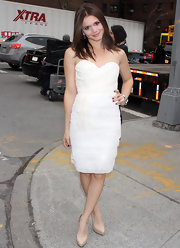 Alexandra Chandro looked pretty in a strapless white pleated dress for the Badgley Mischka show.