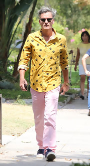 Balthazar wore this yellow button down shirt with a Magic 8 Ball design.