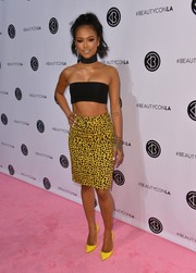 Karrueche Tran teamed her sexy top with a spotted yellow pencil skirt.