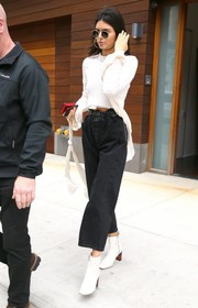 Kendall Jenner headed out in New York City wearing a cropped white sweater by Milly.