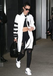 Bella Hadid completed her monochrome look with a pair of Nike sneakers.
