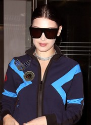 Bella Hadid went for bold styling with a pair of oversized, angular shades by Quay while out in New York City.