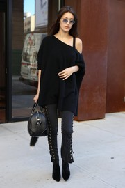 Bella Hadid completed her all-black attire with a pair of stretch velvet boots by Stuart Weitzman.