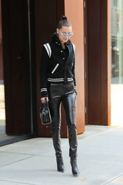 Bella Hadid was sporty-chic in a black-and-white Saint Laurent varsity jacket while out in New York City.
