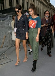 Taylor Hill completed her quirky look with a pair of black combat boots.