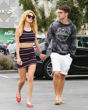 Bella Thorne completed her sporty-sexy outfit with a matching striped mini skirt.