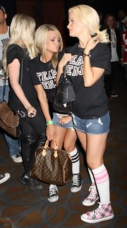 "Holly sported her signature striped socks with pink and black high top ""Chuck Taylors"","