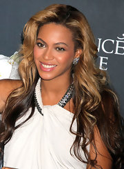 Beyonce wore a pair of large silver and gemstone earrings while at Macy's in NYC celebrating the launch of her fragrance, Pulse.