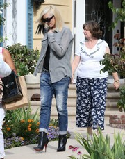 Gwen Stefani was tomboy-chic in a gray button-down layered over a black shirt while visiting her mother.
