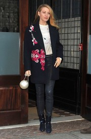 Blake Lively added extra edge with a pair of suede and patent ankle boots by Christian Louboutin.