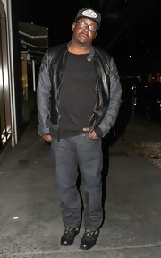 Bobby Brown chose a casual and edgy look with this black leather jacket that featured denim sleeves.