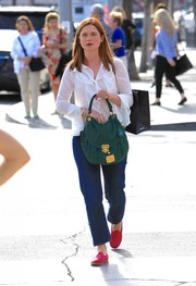 Bonnie Wright kept it laid-back on the bottom half in classic blue jeans.