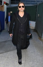 Brad Pitt stuck to his signature dark colors with this black wool coat.