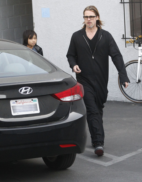 Brad Pitt And Son Maddox Leaving Guitar Center