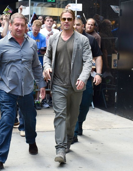 Brad Pitt's gray two-piece suit looked casual but still cool on the actor while out in NYC.