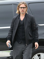 Brad Pitt looked cool in this charcoal zip-up jacket out in New Orleans.