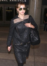 Suki Waterhouse looked oh-so-cool in her Ray-Ban aviators and leather coat as she made her way through LAX.