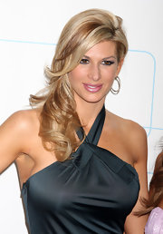 Alexis Bellino went for simple curls on the Bravo carpet. She pinned her side-swept curls to one side, which showed off her haltered emerald green dress.