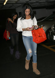 Bria Murphy accessorized with an eye-catching bright orange leather tote when she had her nails done in Beverly Hills.