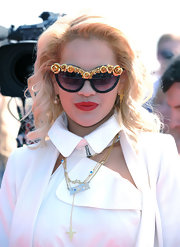 Rita wore rose-adorned cat eyes to the 'X-Factor' auditions in London.