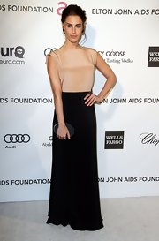 Jessica Lowndes wore a nude and black gown with draped back to Elton John's Oscar party.
