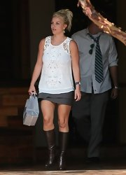 Britney Spears chose a sleeveless, white lace blouse for her daytime look while out with her boyfriend.