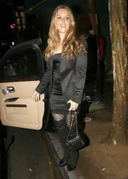 Brooke Mueller went out to dinner carrying a Chanel evening bag. The classic quilted mini features a gold chain strap.
